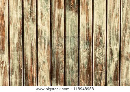 wooden background vertically positioned brown, cracked boards