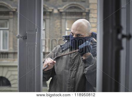 Burglar trying to break in