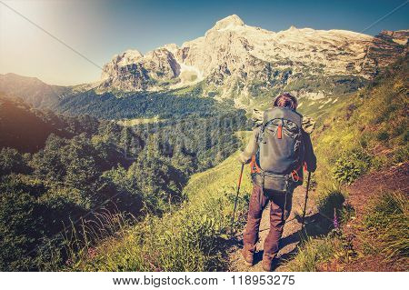 Traveler Man with backpack hiking Travel Lifestyle concept mountains on background Summer trip
