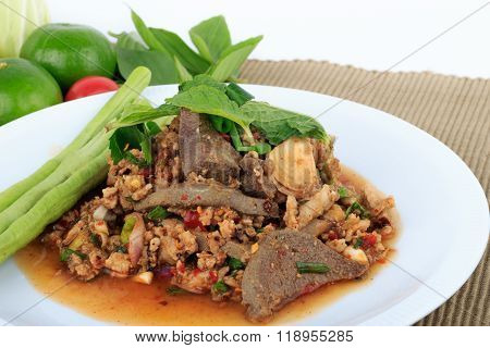 Thai ground pork salad, Spicy minced pork and pork liver salad on Brown Cloth Background
