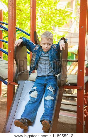 7 Years Old Kid Playing At Children Playground
