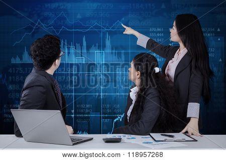 Businesswoman Explaining Financial Statistics
