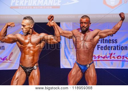 Male Bodybuilders Flex Their Muscles To Show Their Physique