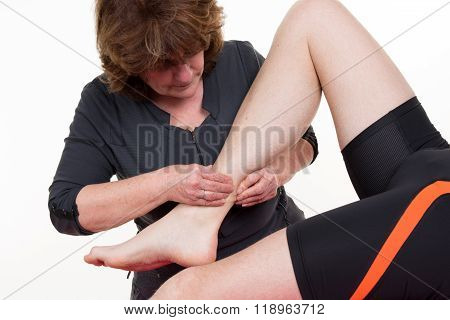 Manual, Physio And Kinesio Therapy Techniques Performed By A Male Physiotherapist On A Training Plas