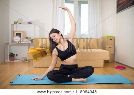 Carefree calm woman meditating.Healthy living.Enjoying peace and serenity.Lotus pose