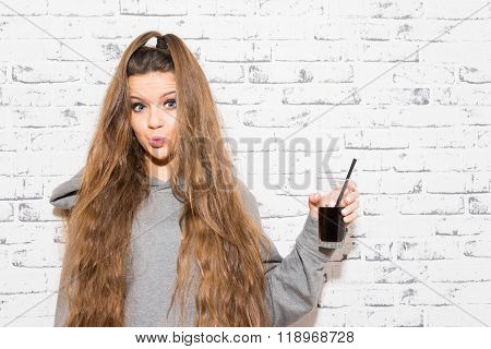 Teenage Girl With Long Hair Holding A Glass Of Cola Drink