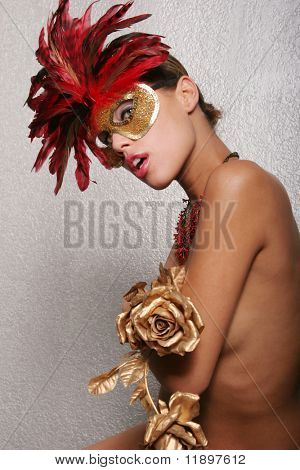 Gorgeous biracial woman with red mask