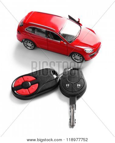 New red car with keys, isolated on white
