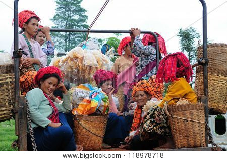 Unidentified Burmese women in a truck in Inle Lake, Myanmar.