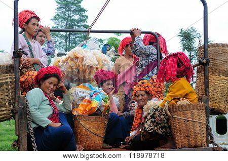 Unidentified Burmese women in a truck in Inle Lake, Myanmar.