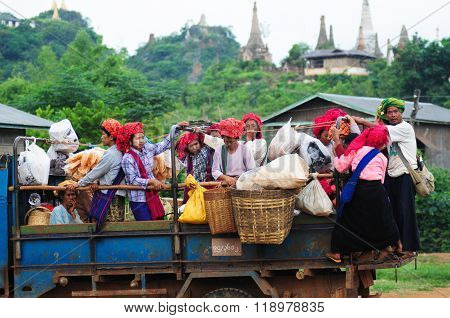 INLE LAKE, MYANMAR, SEPTEMBER 5, 2013: unidentified Burmese women in a truck in Inle Lake, Myanmar. Truck is a popular transportation in Myanmar because it can carry many people.