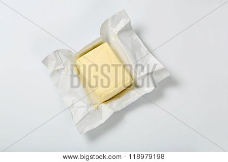 block of fresh butter on white background
