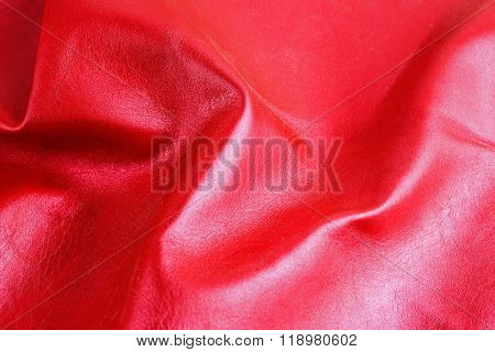 Red shiny leather texture close up