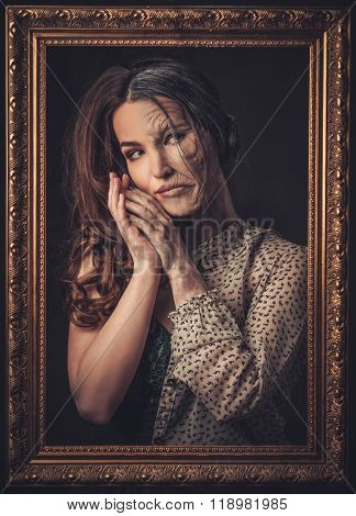 Aging and skin care concept. Half old half young woman with picture frame.