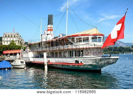 LUCERNE, SWITZERLAND - JULY 3, 2014: The Wilhelm Tell Restaurant. On Lake Lucerne the century old paddle steamer is permanently anchored and a first class restaurant.