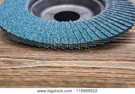 Abrasive wheels on wooden background in studio