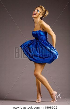 Woman in blue mini dress