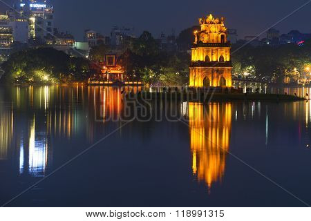 Panorama of Hoan Kiem lake with the Turtle tower in the foreground. Night Hanoi