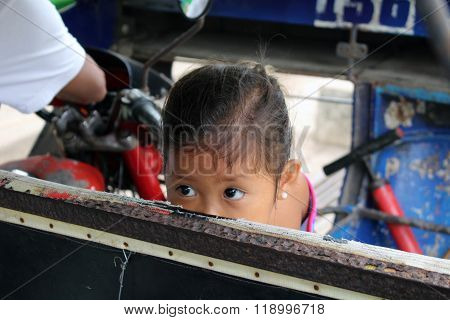 Girl looking from a tricycle