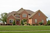 image of manicured lawn  - Single family red brick home with lawn and sidewalk - JPG