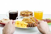 picture of scrambled eggs  - Stock image Point of view of man about to eat a hearty breakfast - JPG