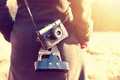 Girl With Retro Vintage Camera. poster