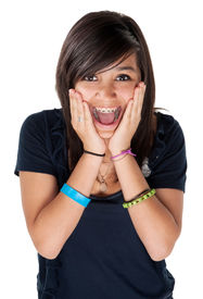 pic of teenage girl  - Young latina girl surprised and hands on chin with big smile on white background - JPG