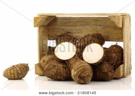bunch of taro root(colocasia) in a wooden crate