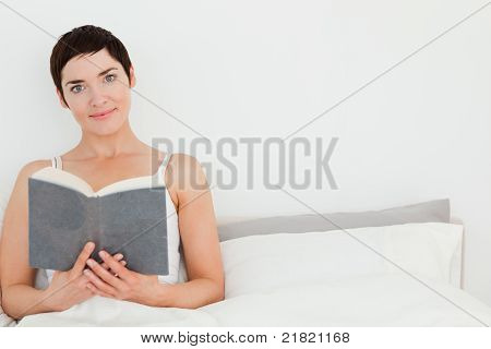 Close Up Of A Brunette Holding A Book