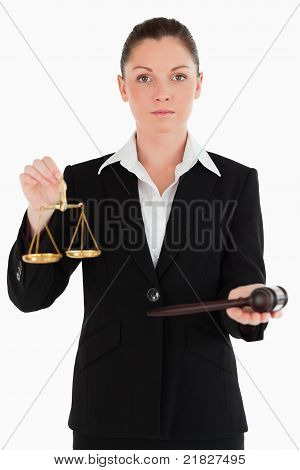 Pretty Woman In Suit Holding Scales Of Justice And A Gavel