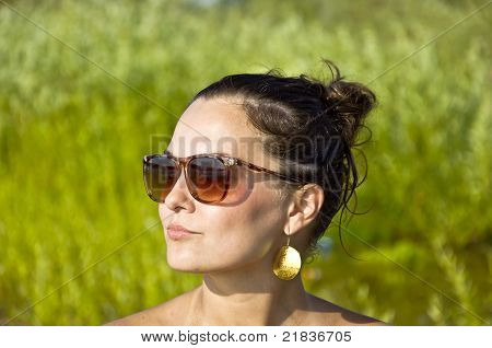 girl in sunglasses on the beach