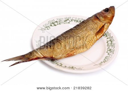 Color photo of a herring on dish
