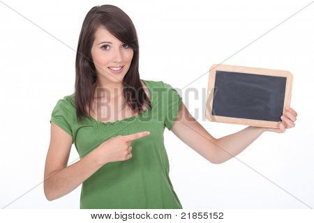 woman pointing a slate