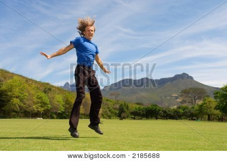 Young Man With Long Blond Hair Is Landing