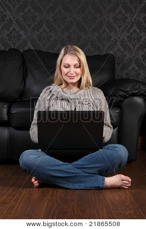 Young Woman On Floor At Home Surfing Internet