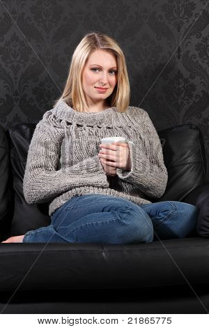 Happy Young Woman Feet Up Enjoying Coffee Drink