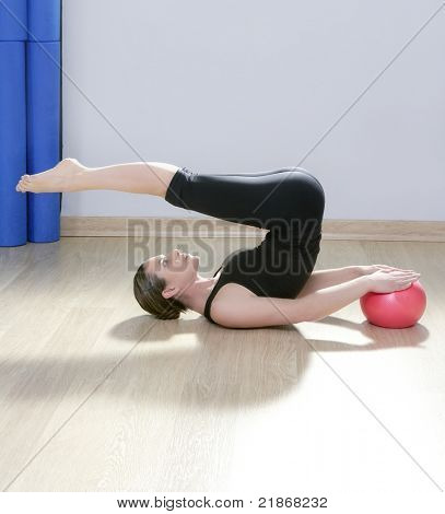 pilate instructor woman with stability ball doing gym fitness yoga exercises