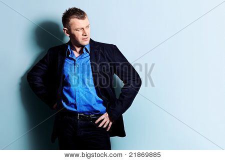 Portrait of a handsome man in a suit. Studio shot.