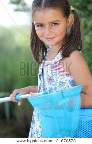 Young girl with a fishing net