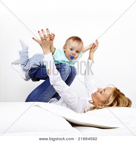 young mother with her son on the bed
