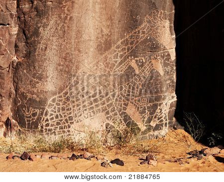 Ancient rock engraving in Sahara Desert, Tadrart, Algeria