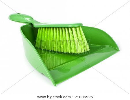 Green scoop with a broom on a white background