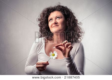 Woman wavering a daisy