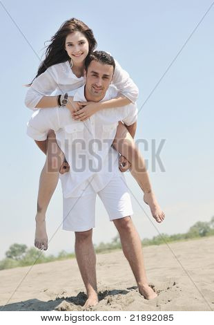 happy young couple have fun and romantic moments on beach at summer season and representing happynes and travel concept