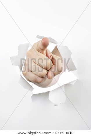 Finger Pointing Through Hole In Paper