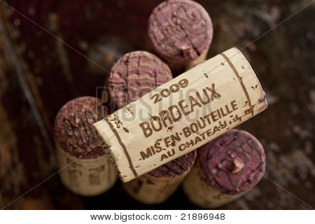 Close up shot of a collection of generic corks from Bordeaux red wine region, focus on one object