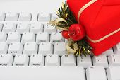 picture of christmas-present  - Christmas present on computer keyboard  - JPG