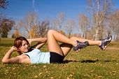 picture of hottie  - Young woman doing a bicycle ab exercise - JPG