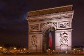 Paris Arc de Triomphe Triumphal Arch at Chaps Elysees at night, Paris, France. Architecture and land poster