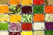 Top view of salad bar with assortment of ingredients poster